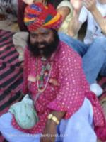 Bearded Indian man in brightly colored turban, total cultural immersion